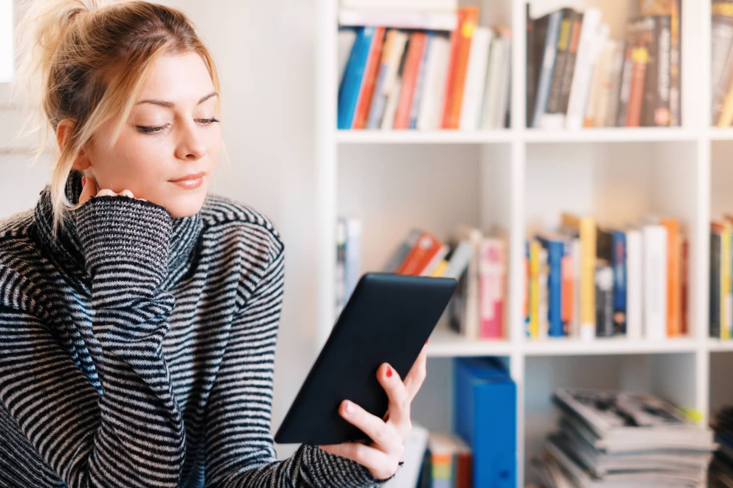 9 E-Reader Hacks That Will Help You Save Money, Share Books With Friends, and Read More Than Ever