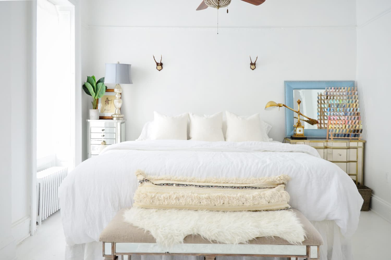 6 Tricks Home Stagers Use to Make Your Bedroom Feel Way Cozier