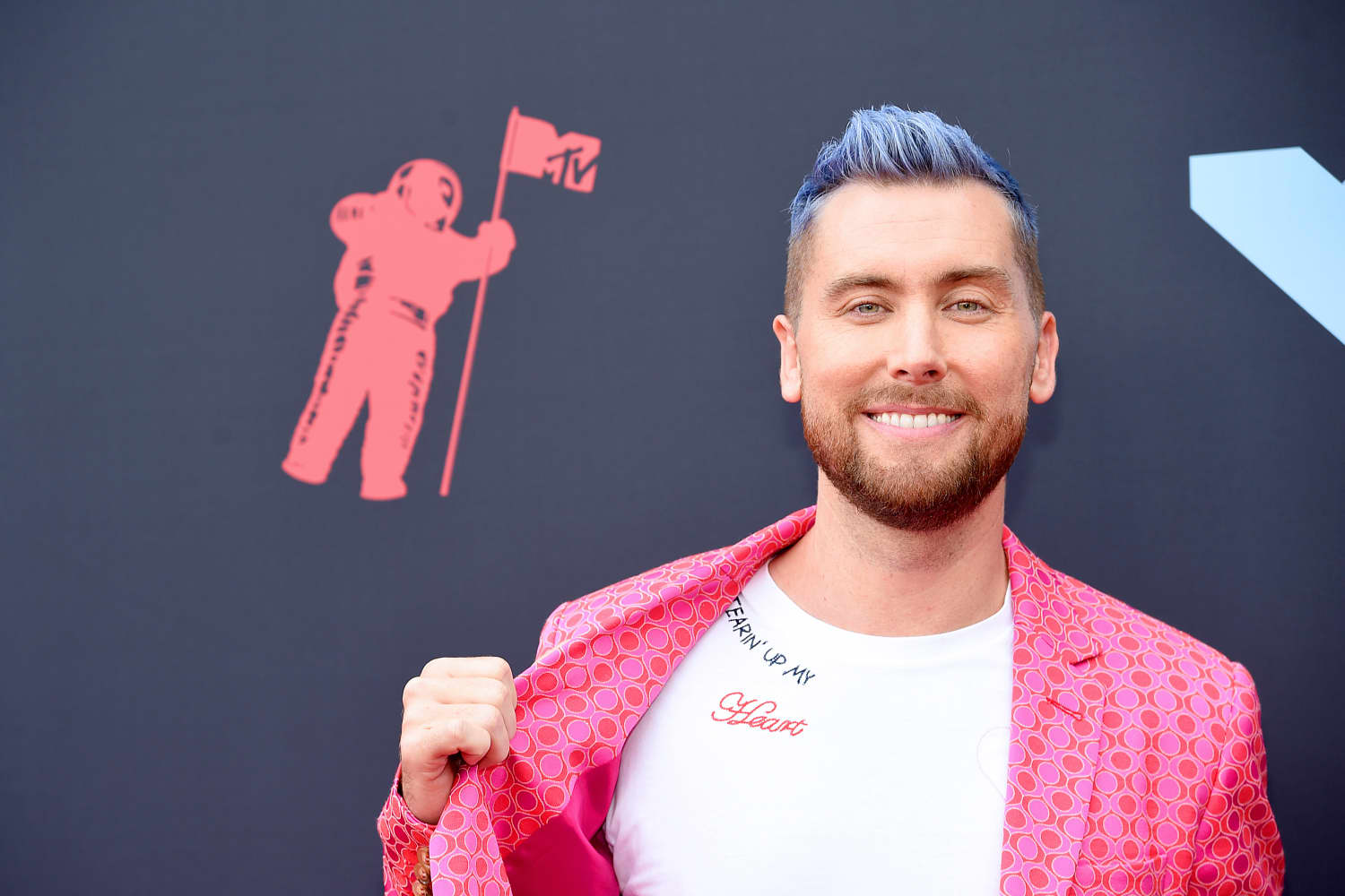 Lance Bass' Purple Tufted Couch Is Anything But Boring
