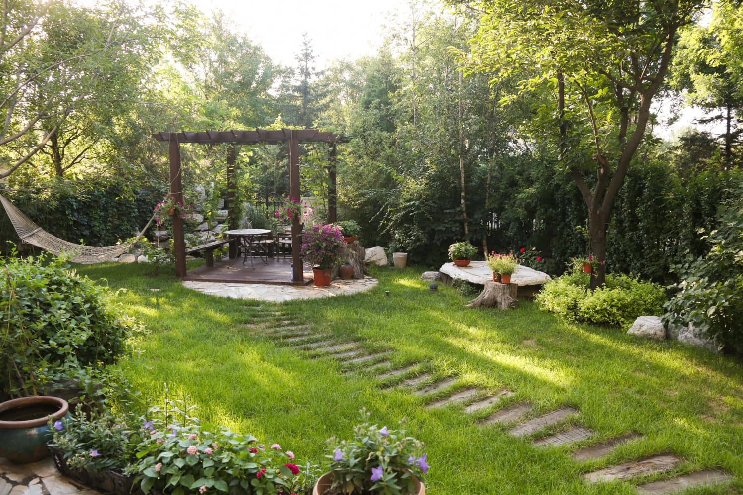 6 Things Making Your Yard Feel Smaller Than It Actually Is, According to Real Estate Experts