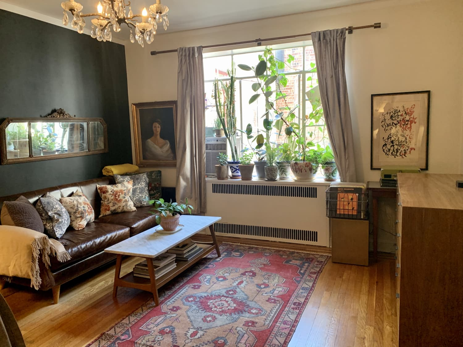 A 450-Square-Foot Shared NYC Studio Apartment Features Dark Walls, Good Art, and Lots of Plants