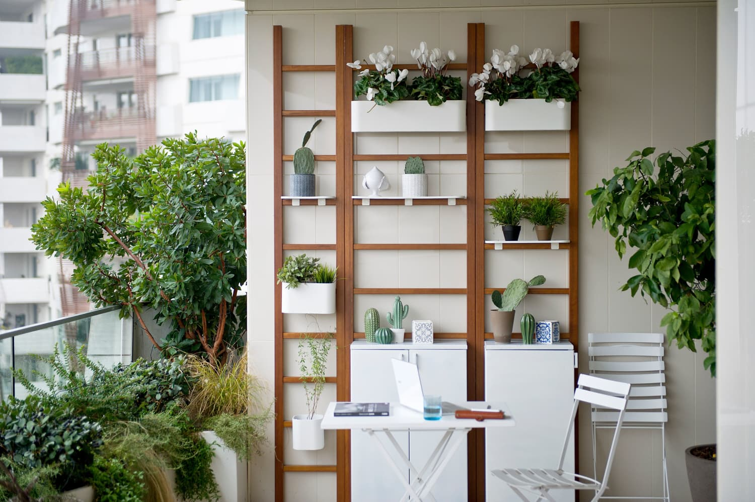 These Chic Wooden Ladders Are The Perfect Solution For Making the Most of Small Outdoor Spaces