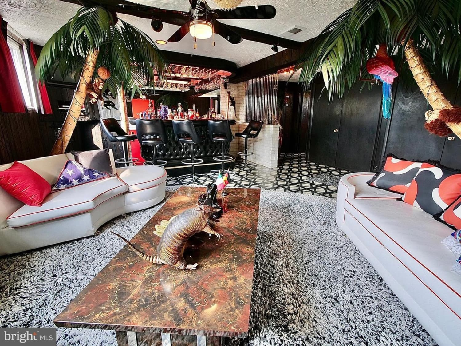 """Peek Inside This Split-Level for Sale with a Basement Speakeasy Called """"the Boom Boom Room"""""""