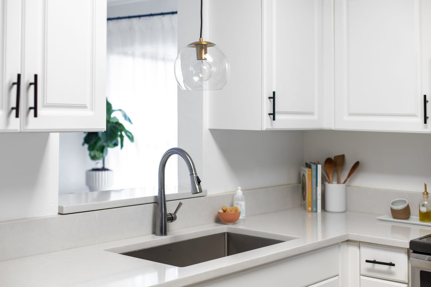How To Clean Those Greasy Glass Shades on Your Kitchen's Pendant Lights