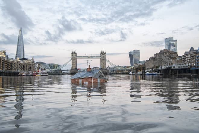 Activists Dropped a Sinking House into a River to Show the Severity of Climate Change