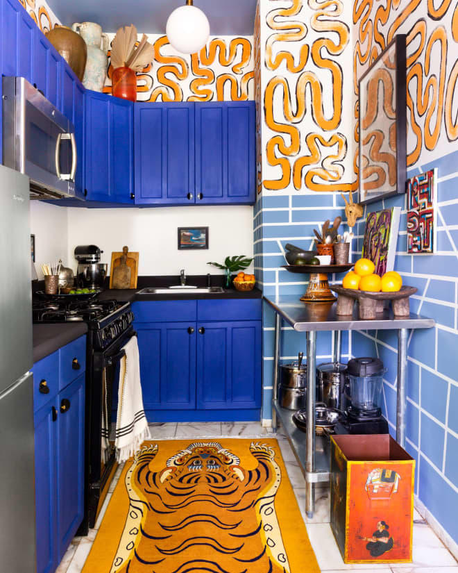 A Rental Kitchen Goes To The Wild Side With Animal Motifs, Paint, and Prints