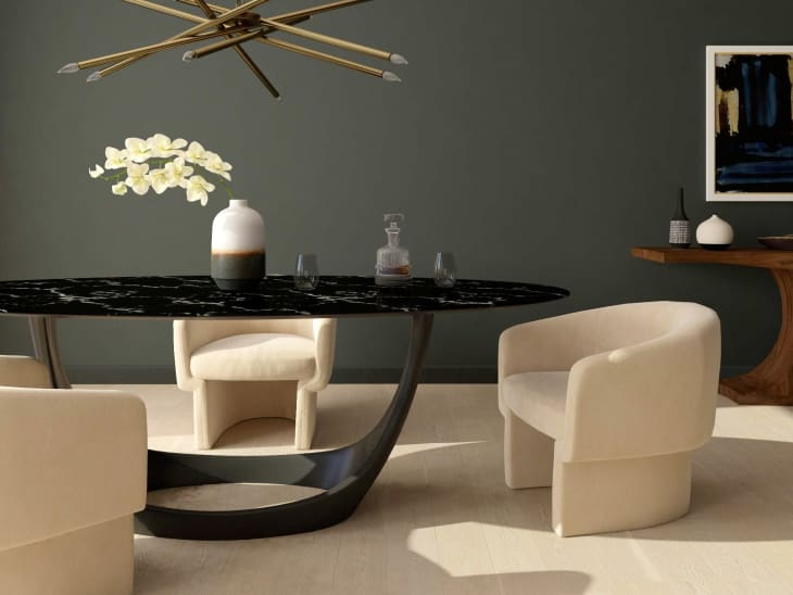 Black stone dining table with curved white dining chairs