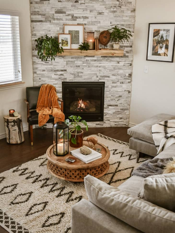 Living room with gray tile fireplace and bohemian rug.