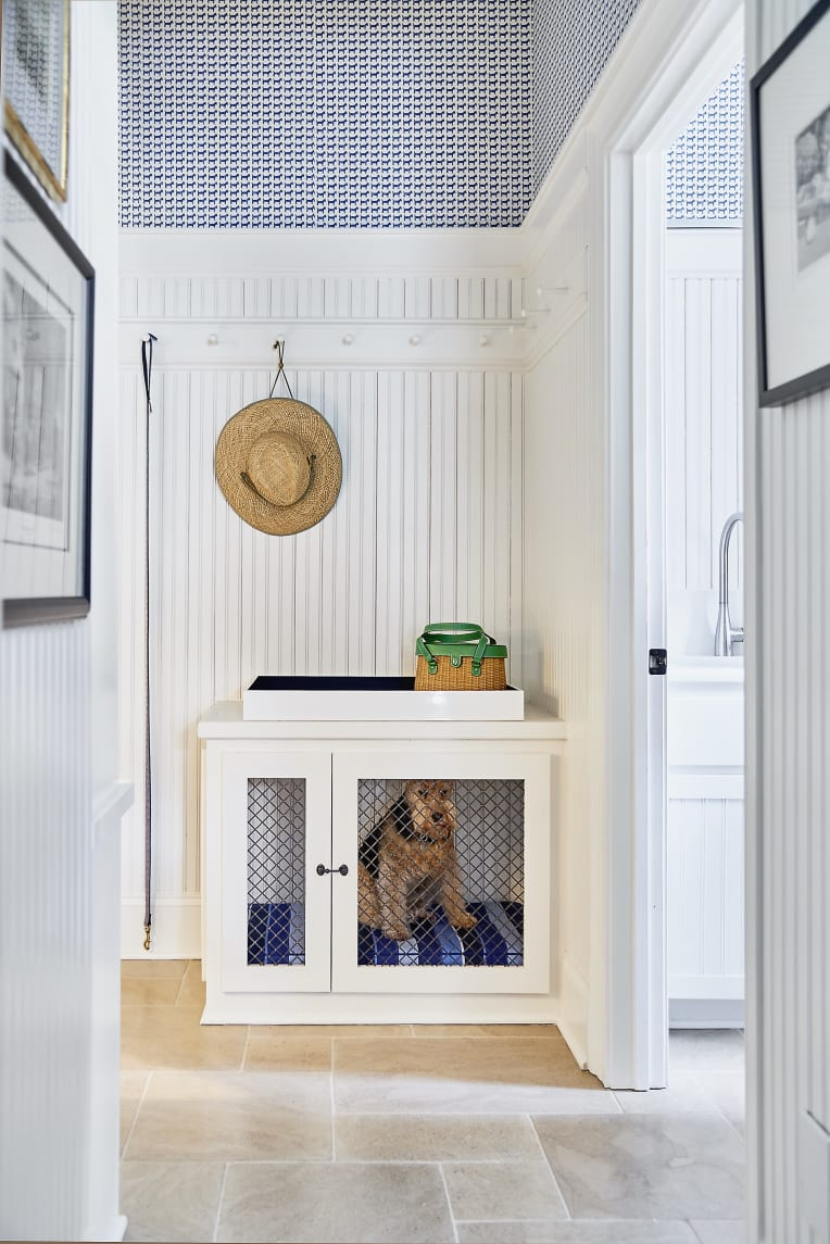 Hallway with dog crate that doubles as drop station for keys and bags