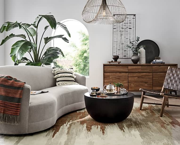 Kidney Bean shaped sofa from Crate & Barrel in gray color