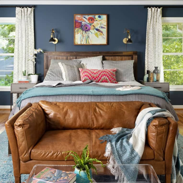 Loveseat at the foot of a bed