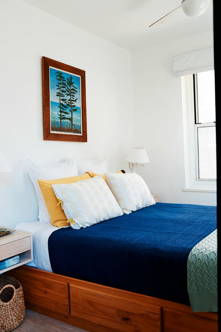 Bed with drawers underneath it in Laura Fenton's home