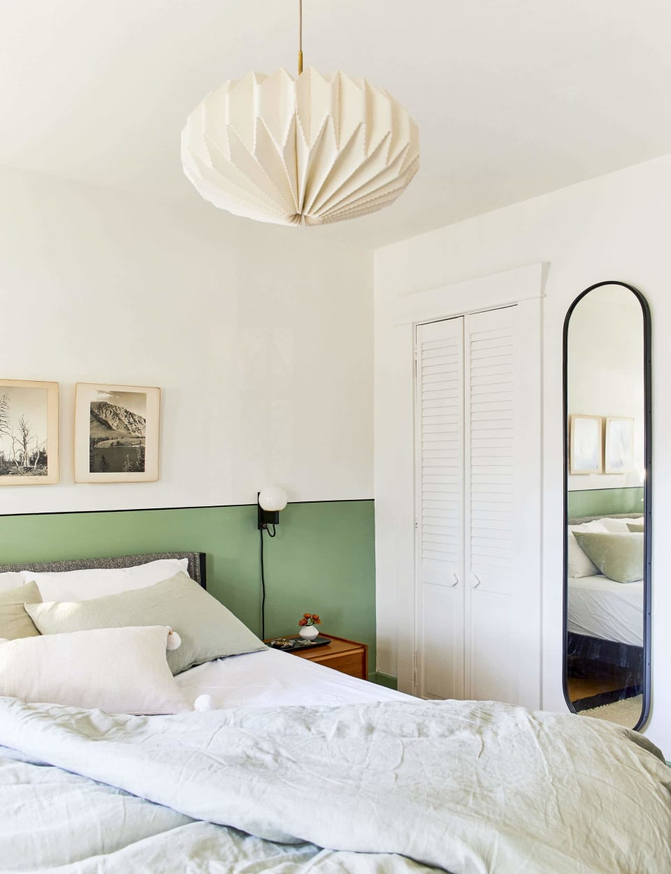 Julie Rose wall-to-wall wainscoting behind the headboard