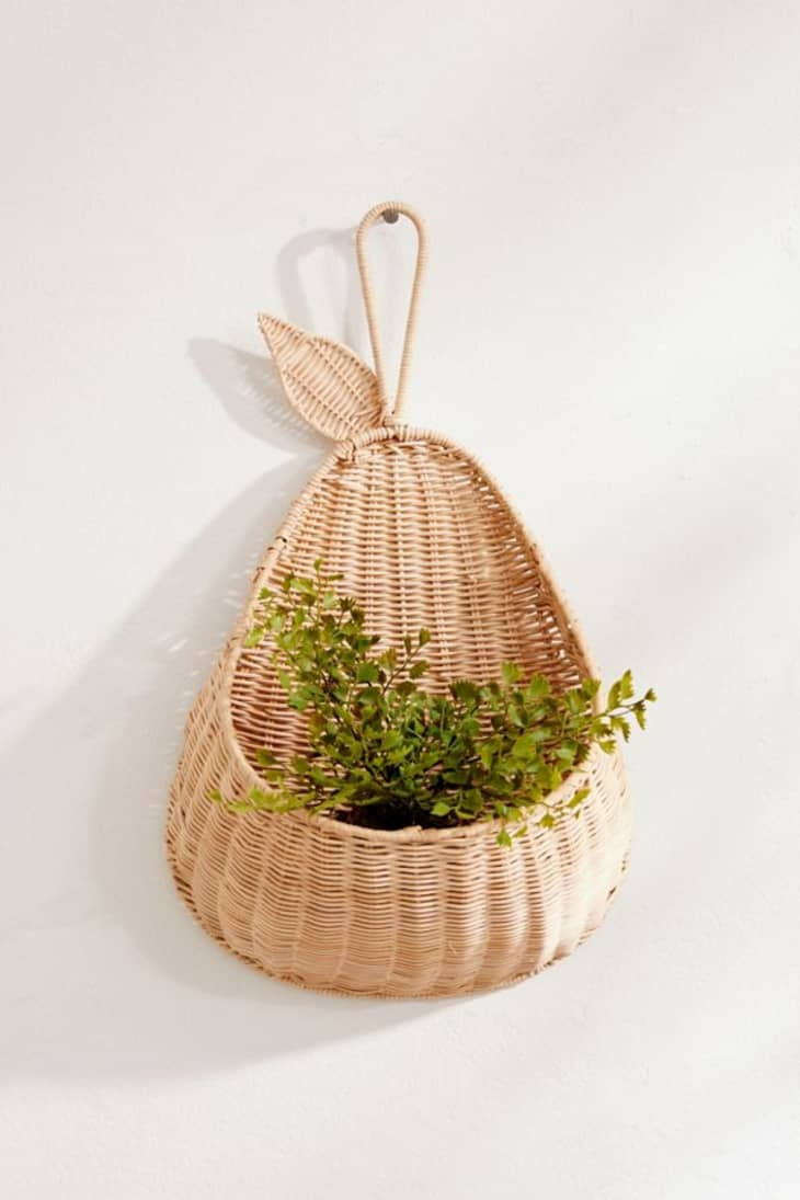 Hanging Wicker And Rattan Basket Planters Apartment Therapy