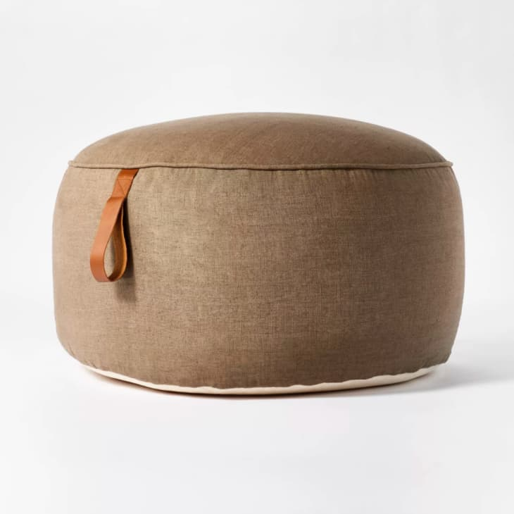 Light brown linen pouf with cognac leather strap
