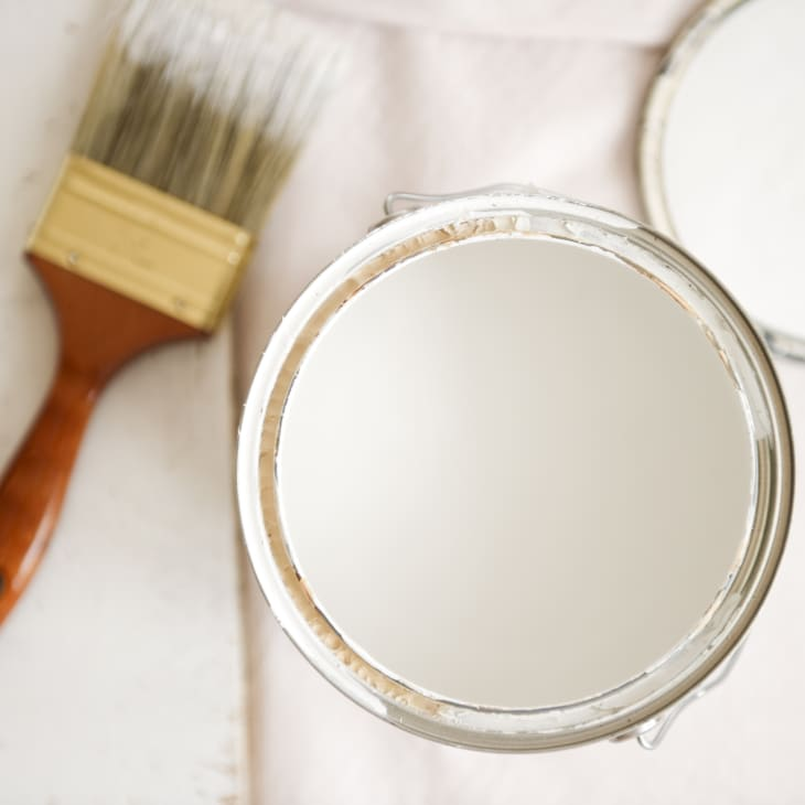 close up of paint can and paint brush