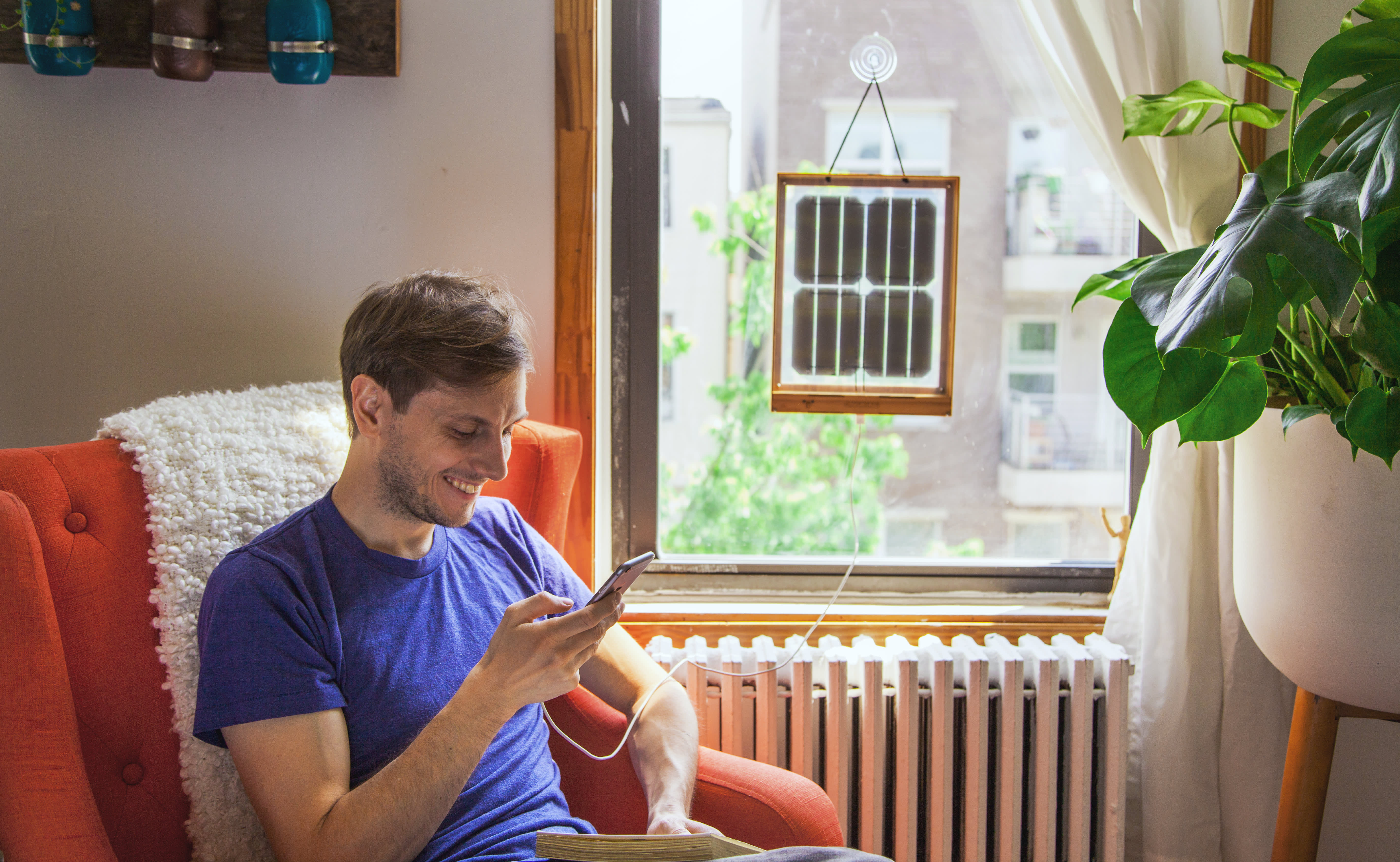 This Renter-Friendly Solar Panel Hangs In Your Window and Charges Your Devices