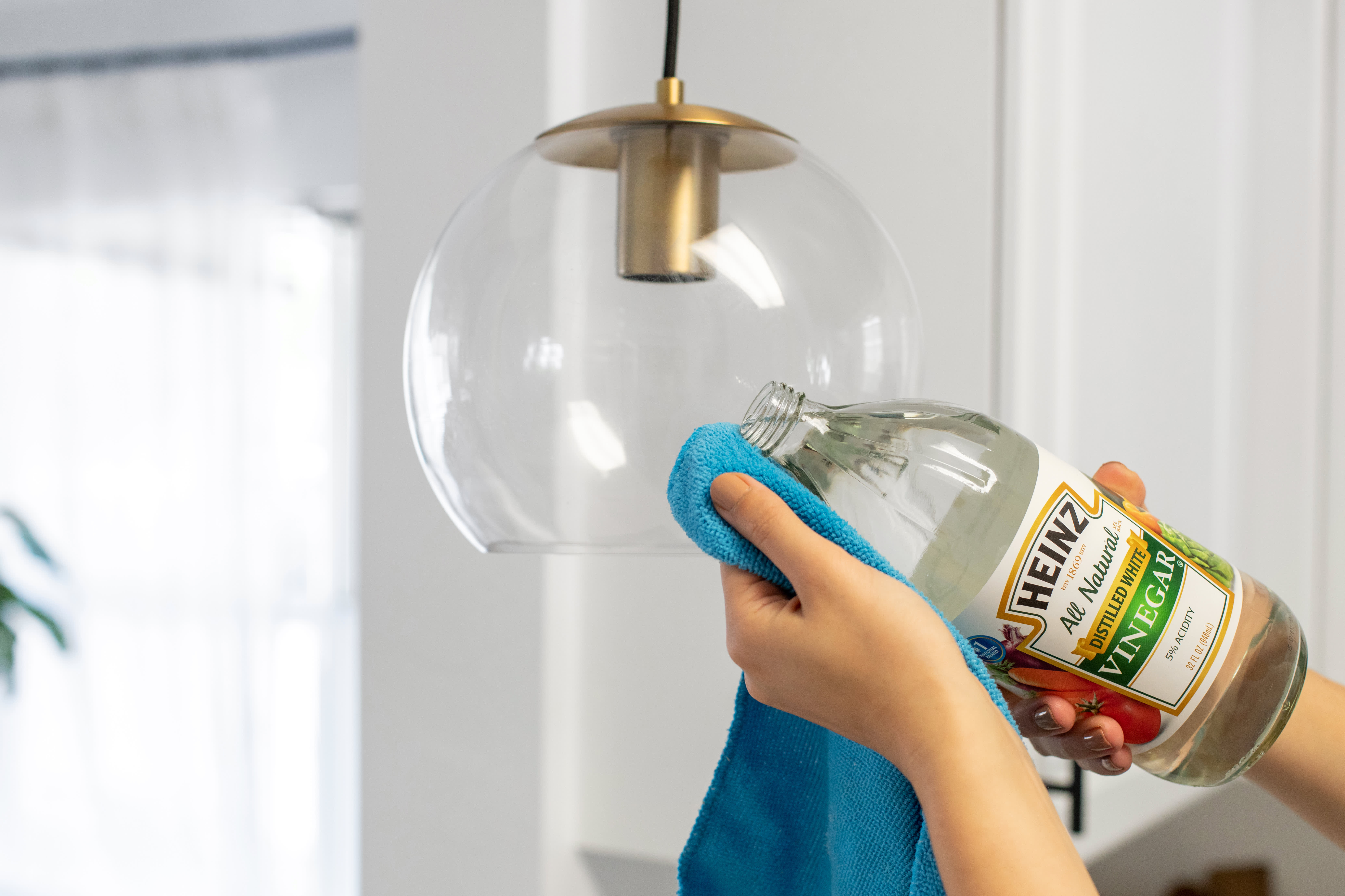 How To Clean Those Greasy Glass Shades on Your Kitchen's Pendant Lights: gallery image 6