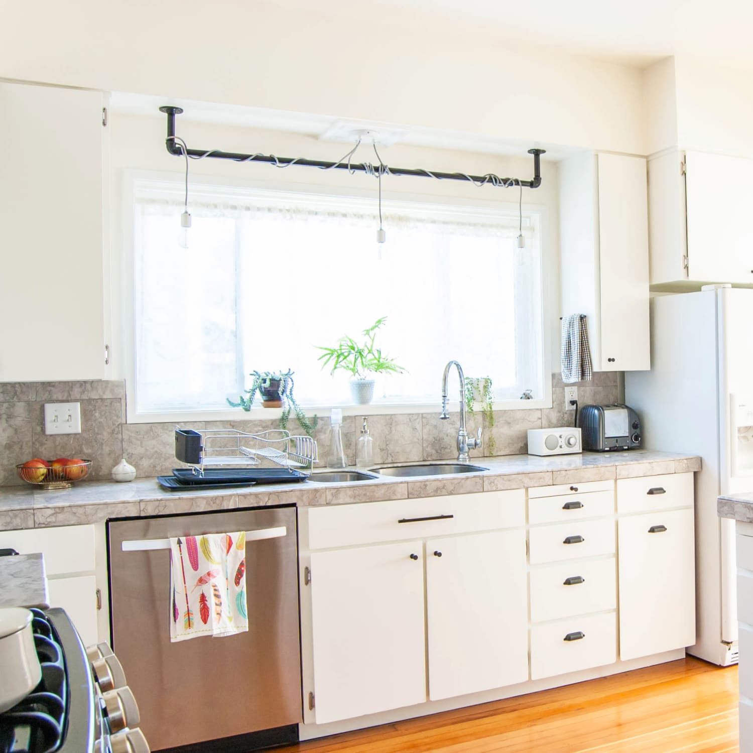 Here S How Hidden Cabinet Hacks Dramatically Increased My Kitchen Storage Apartment Therapy