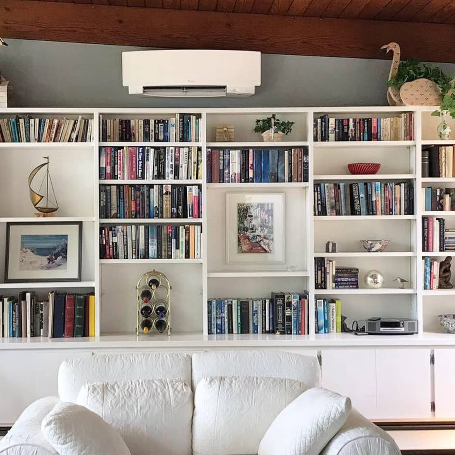 Before And After A Bold Living Room Bookshelf Transformation For Less Than 100 Apartment Therapy