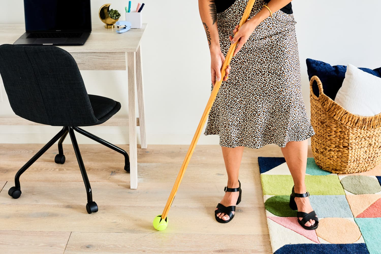 Stick a Tennis Ball on the End of Your Broom to Make a Super-Powered Cleaning Tool