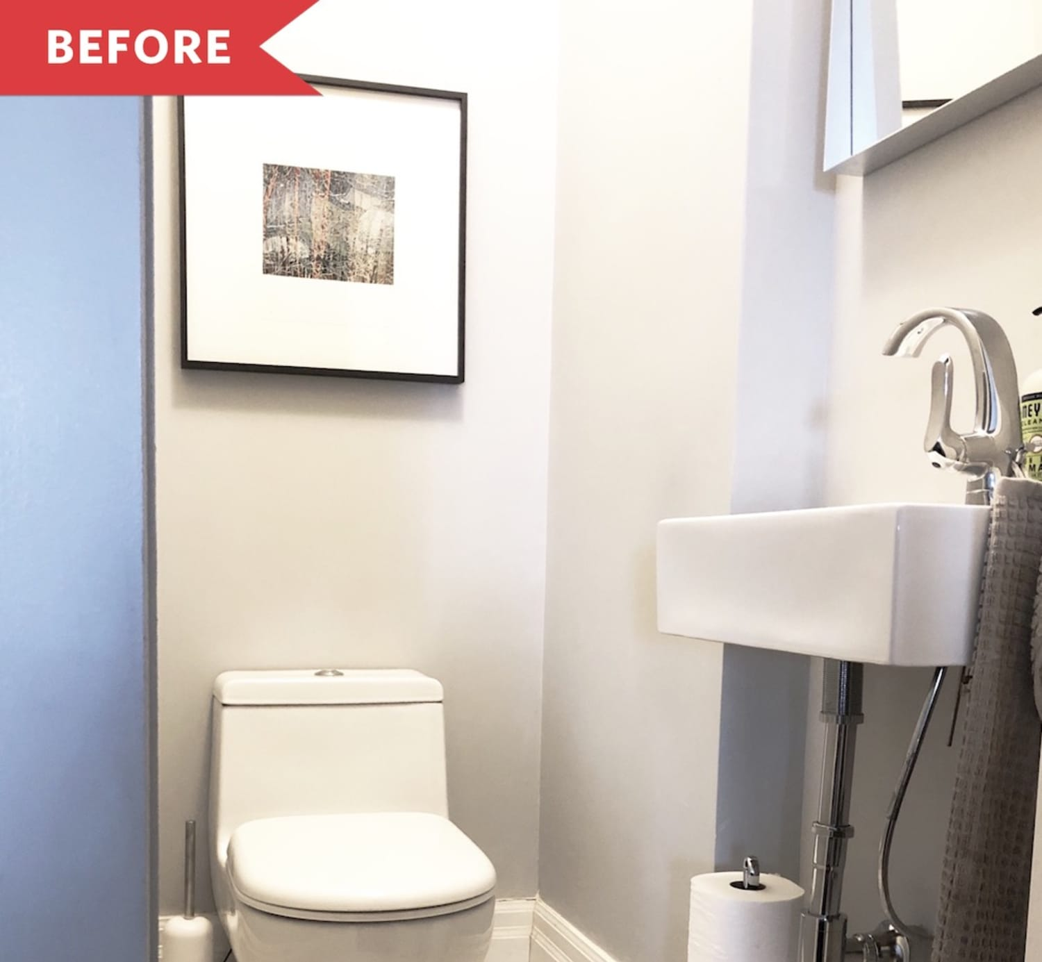 Before and After: Black Paint Made This Powder Room Feel So Much Warmer