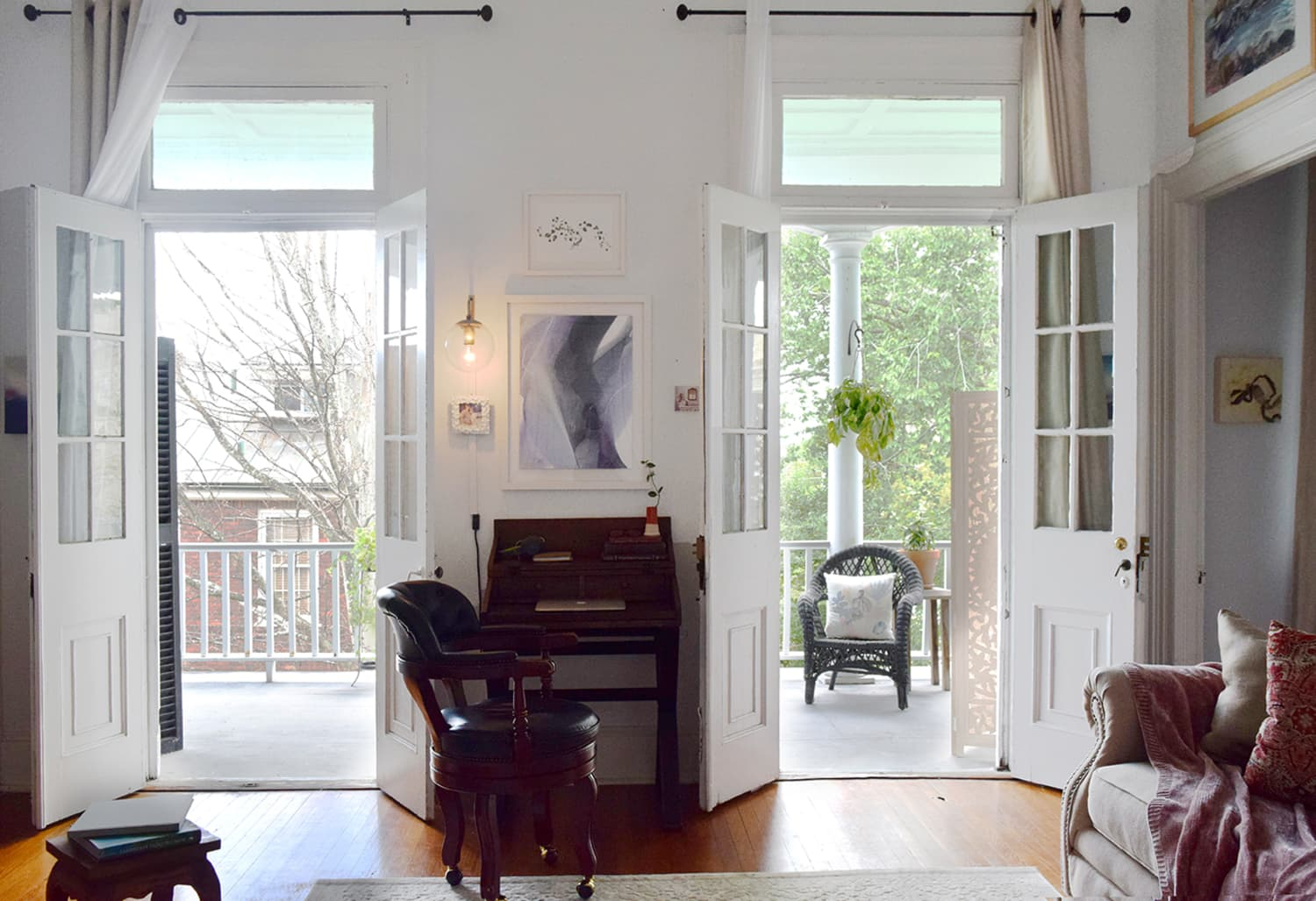 A Small Apartment in an Old House Has Smart, Money-Saving Solutions for Covering Tall Windows