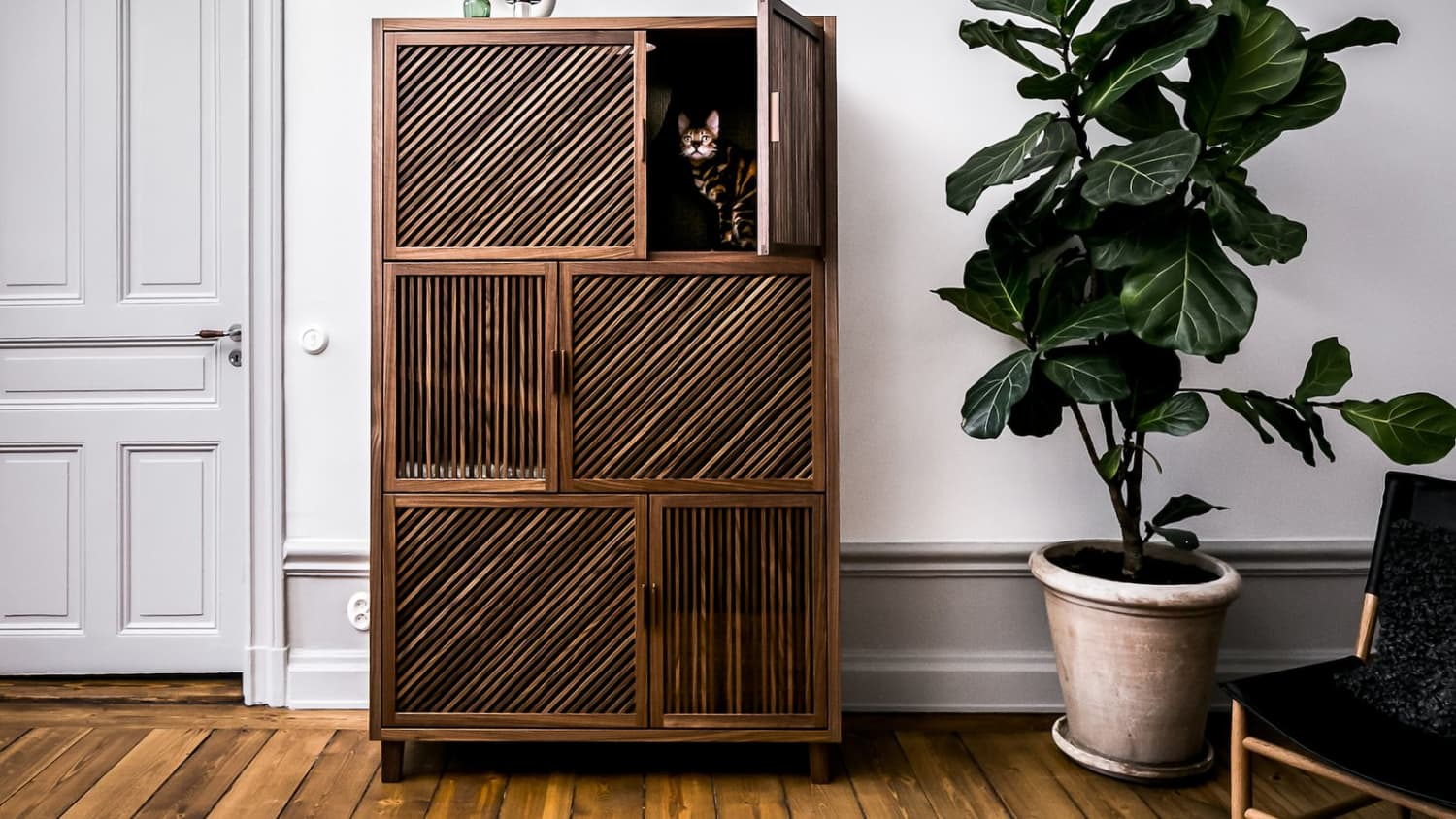 This Bespoke Cabinet Opens Up to Reveal A Hidden 'Cat Flat'