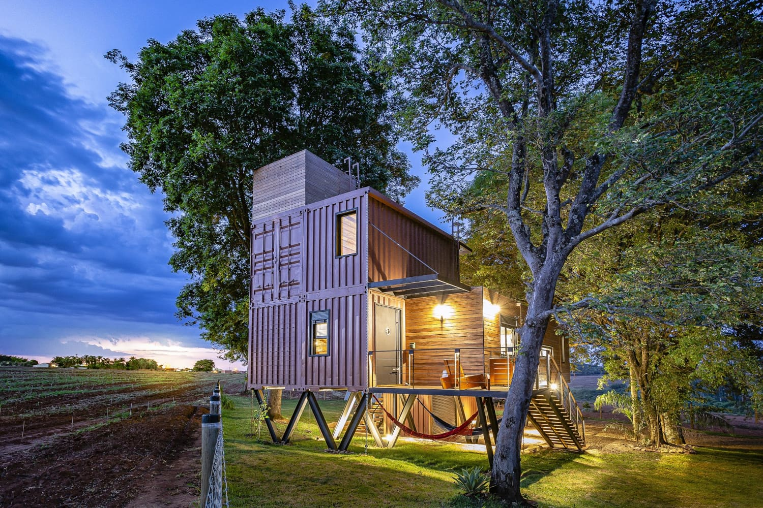 This Eco-Friendly Shipping Container House Is Suspended Off the Ground to Blend In with Nature