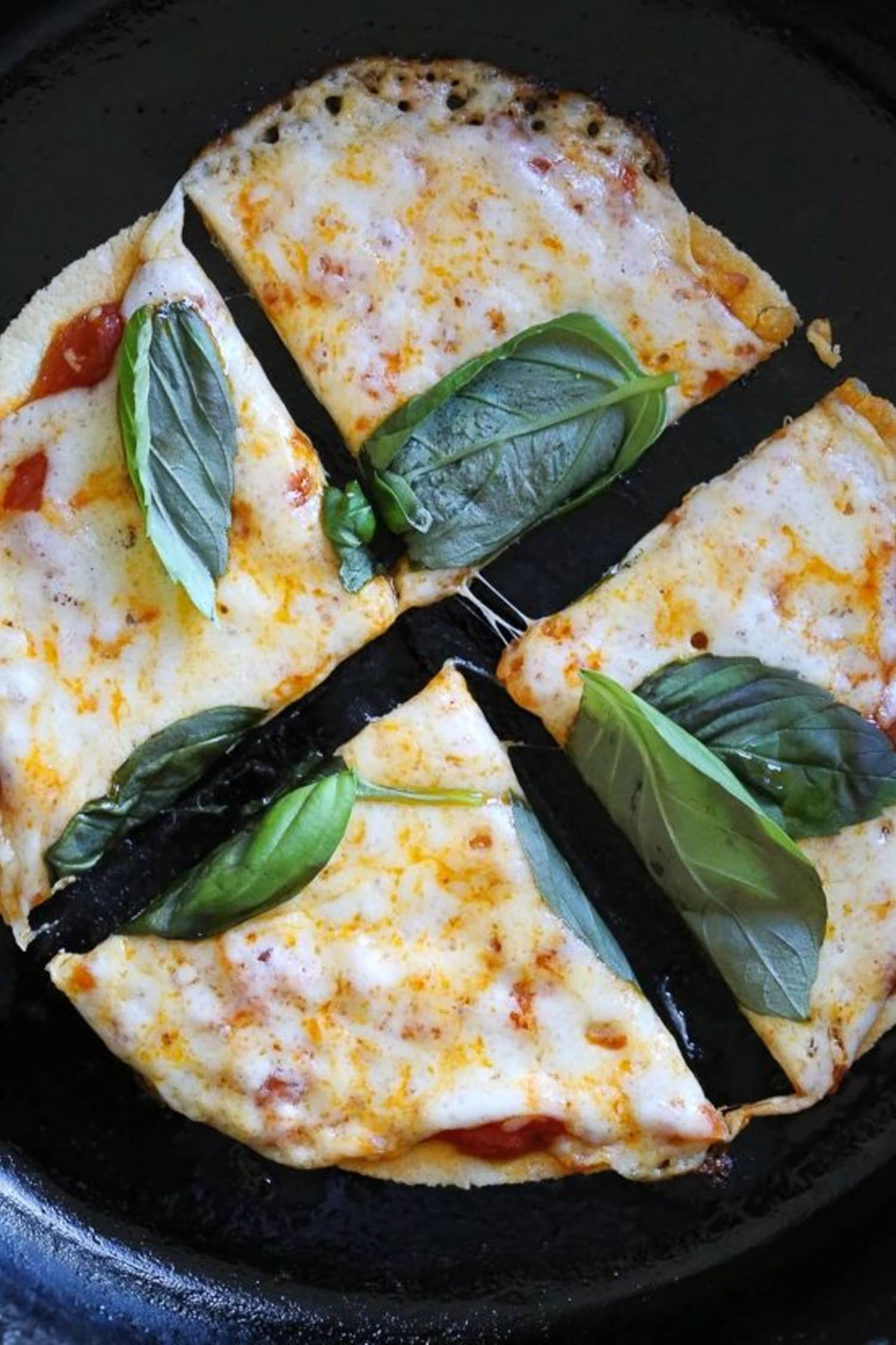 Here's How to Make the Quickest Thin-Crust Pizza in Your Cast Iron Pan