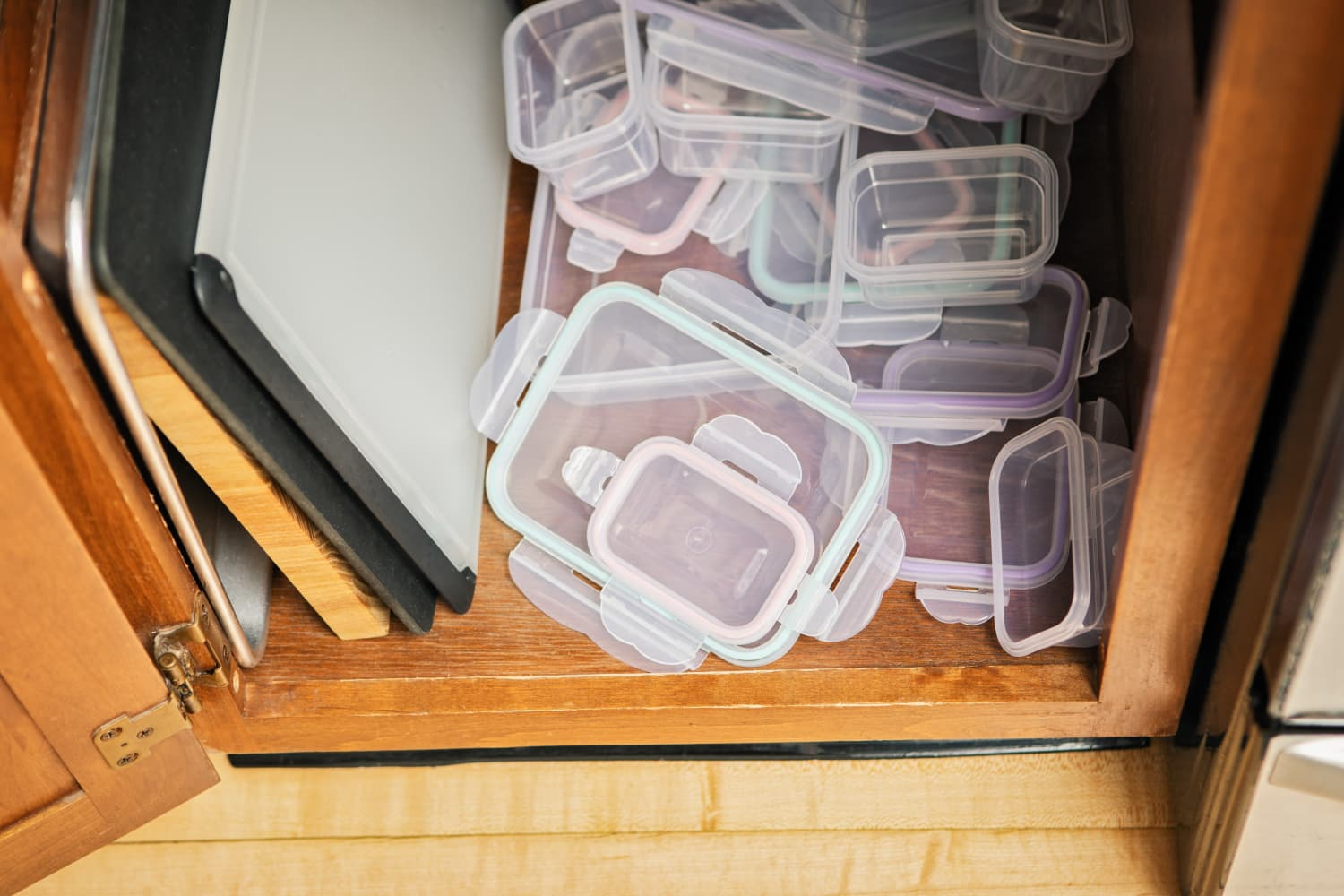 A $10 Mail Organizer Is the Key to Organizing Messy Food Container Lids