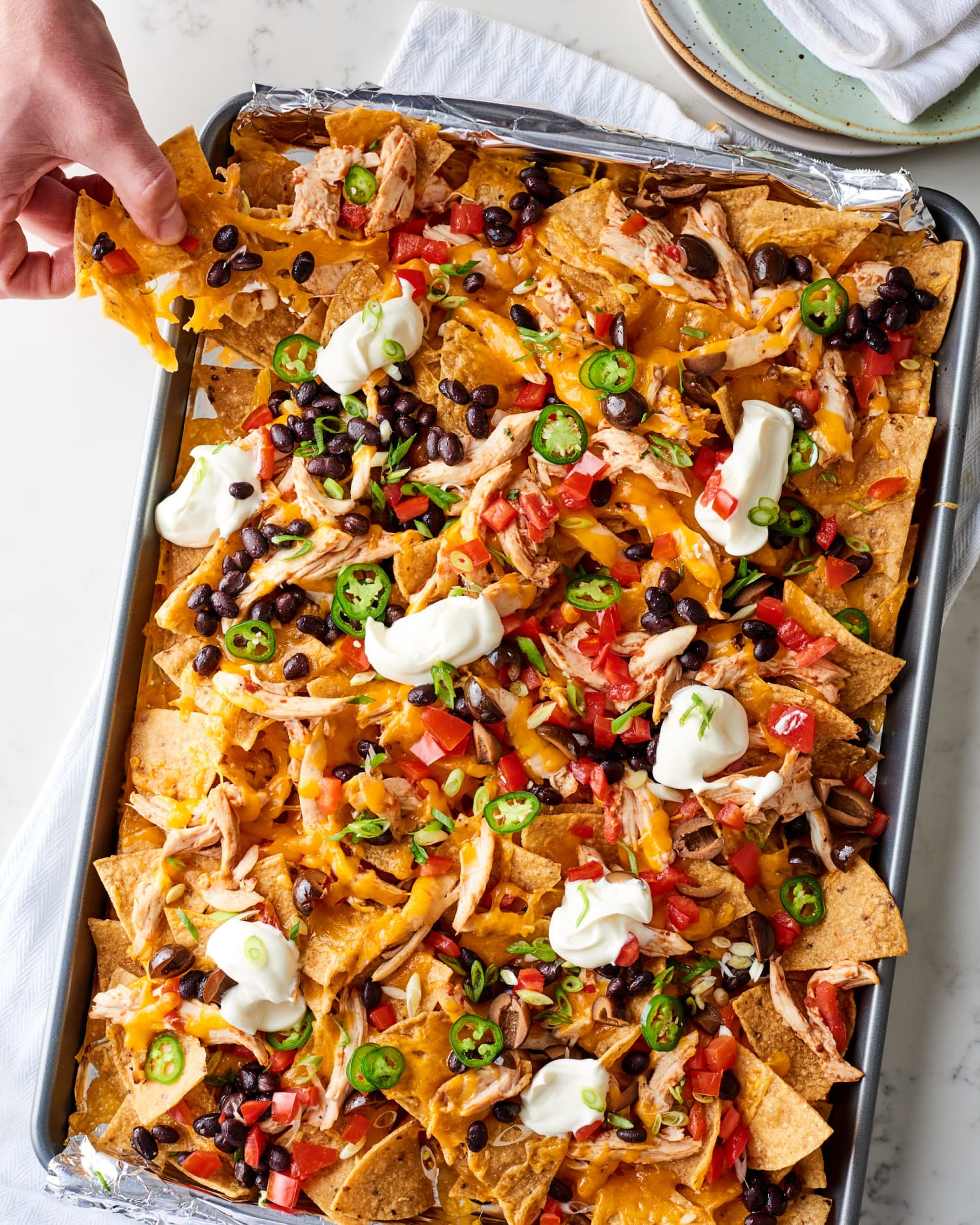 These Cheesy Chicken Nachos Will Make You a Dinner Hero