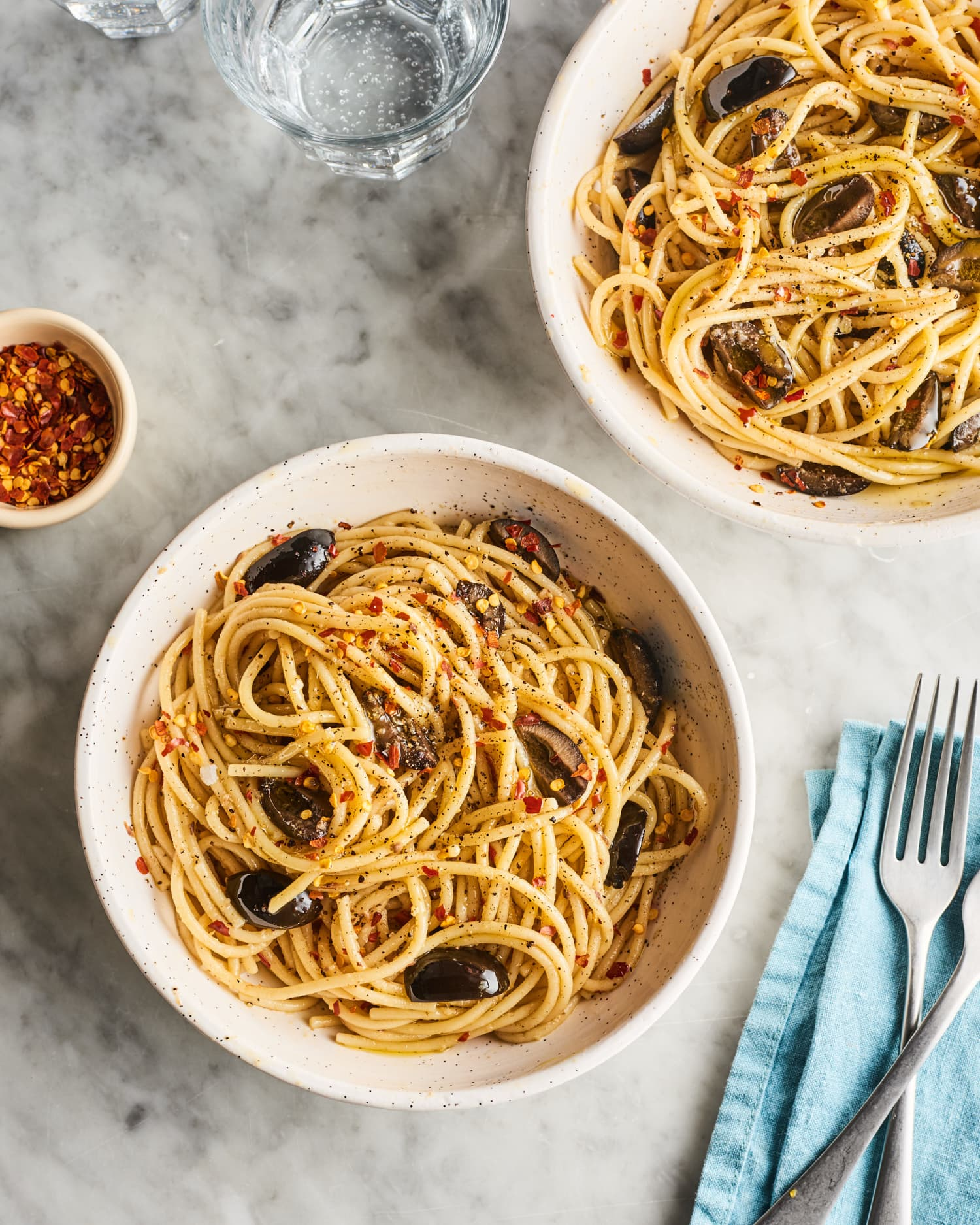 Garlic, Anchovy, and Olive Spaghetti Is an Easy Pantry Favorite