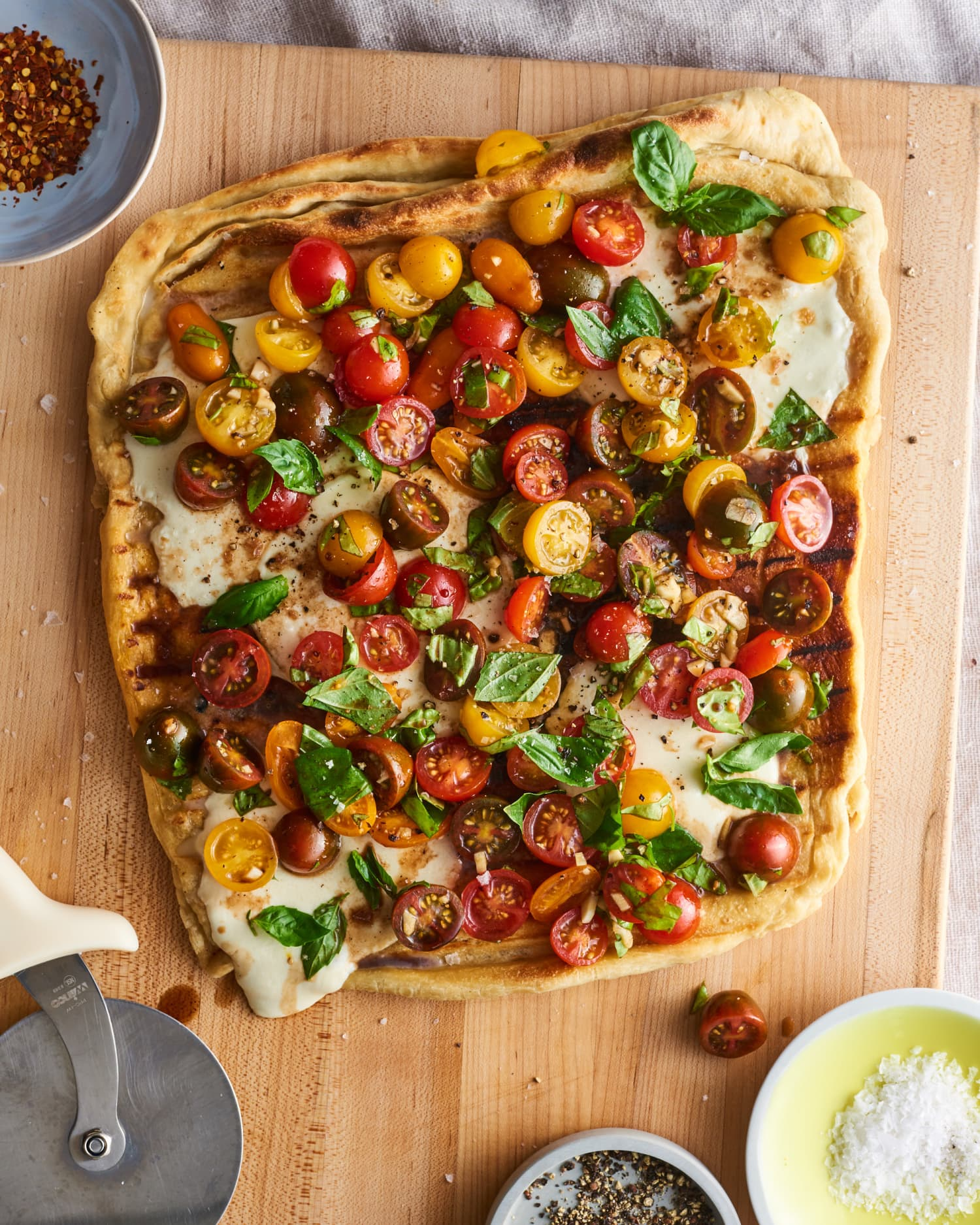 This Garlicky Bruschetta Pizza Is the Best Way to Enjoy Sweet Summer Tomatoes