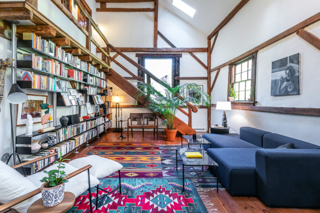 This Converted Dairy Barn for Sale Boasts a Wall of Books