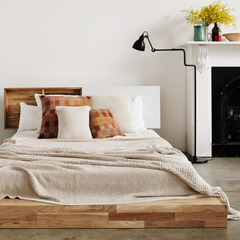 10 Multi-Tasking Bookcase Headboards That'll Help You Maximize Your Small Space