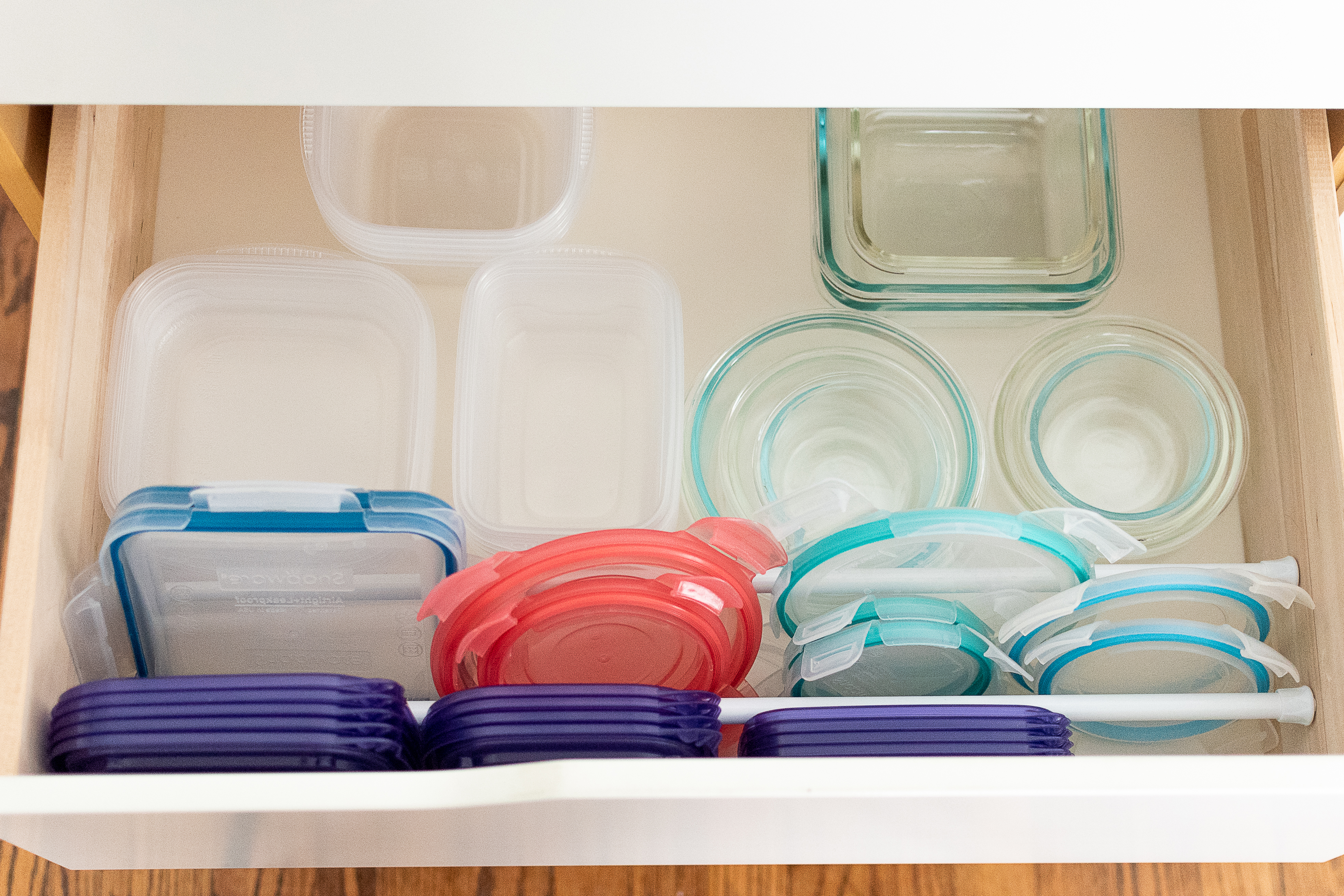 10 Clever Ways To Organize Tupperware And Food Storage Containers